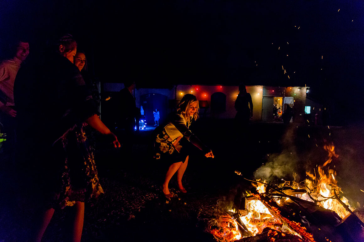 Guests enjoy an evening bonfire