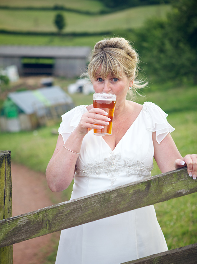 The bride enjoys a well earned pint!