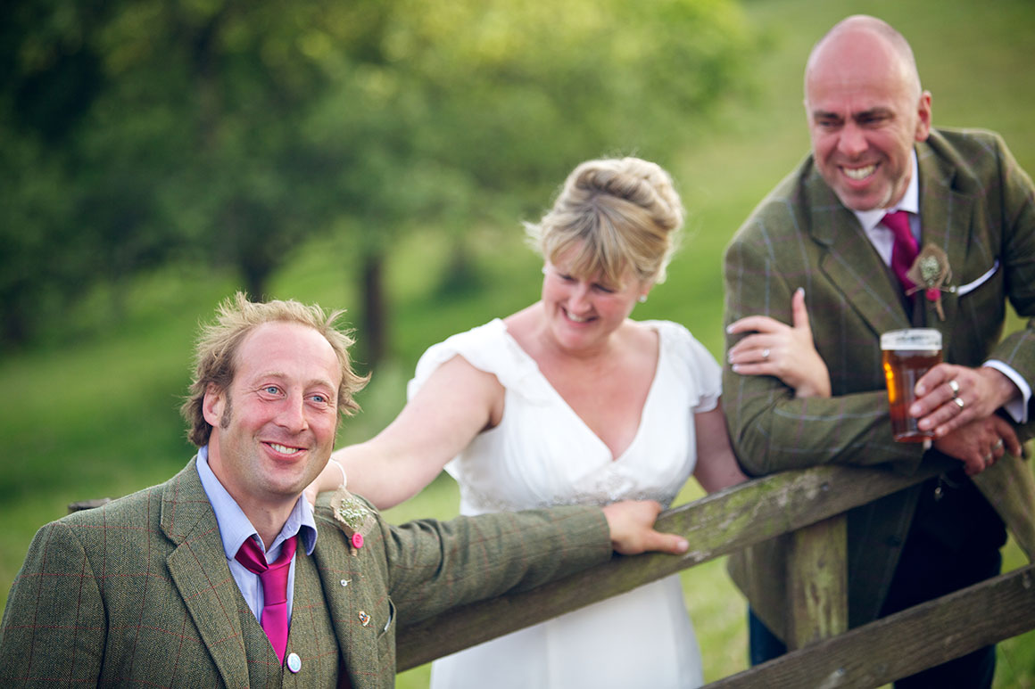 Bestman, bride and groom enjoy a joke